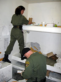 Pelican-Bay-SHU-guards-search-cell-for-binder-clip-weapon-2006-by-Laura-Sullivan-NPR, Liberate the Caged Voices, Behind Enemy Lines