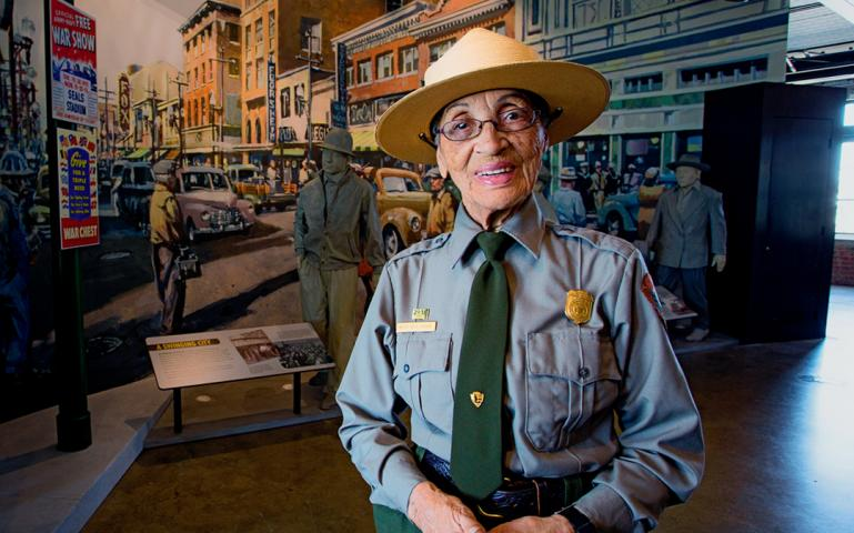 Betty-Reid-Soskin-in-front-of-mural-at-Rosie-the-Riveter-World-War-II-Home-Front-National-Historical-Park-in-Richmond-2016-by-Edward-Caldwell, On Sunday, Rosie the Riveter Trust will celebrate 'We Can Do It!' spirit and park ranger Betty Reid Soskin's 100th birthday, Culture Currents Featured