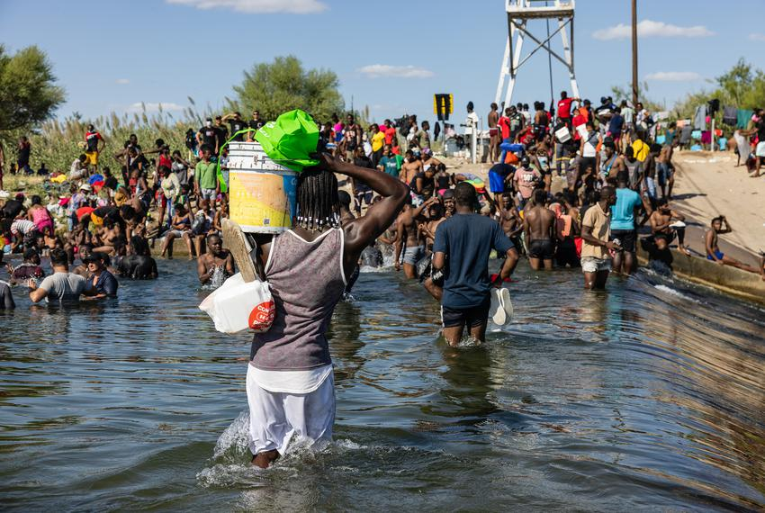 Haitian-refugees-cross-the-Rio-Grande-for-supplies-for-their-camp-under-the-bridge-from-Mexico-to-Del-Rio-TX-091621-by-Jordan-Vonderhaar-Texas-Tribune, Abuse of refugees exposes the White House's long-standing policy towards Haiti, World News & Views
