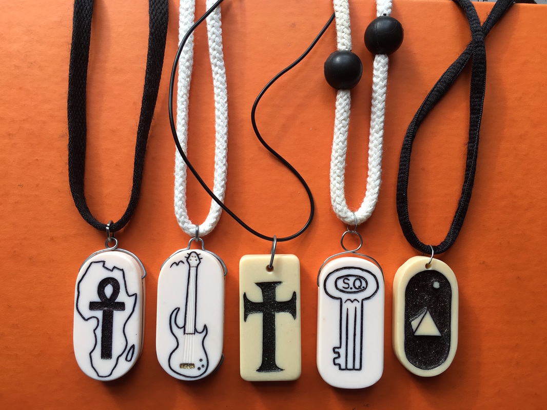 Hand-etched-domino-pendants-created-by-death-row-artist-James-P.-Anderson, Guards steal from a California death row artist and he gets the hole, Behind Enemy Lines